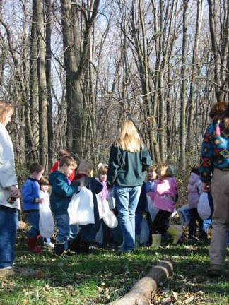 School children enjoying the forest with their teachers.